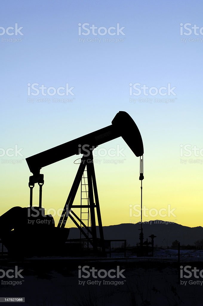 A shadowed image of an oil pump stock photo