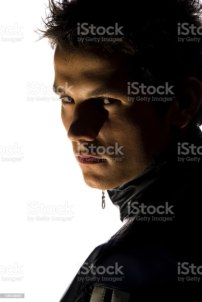 A shadowed portrait of a young man stock photo