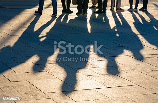 istock Shadows and silhouettes of people at a city during sunset 853989078