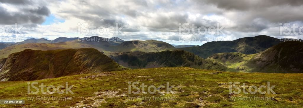 Shadows and sunshine over the fells stock photo