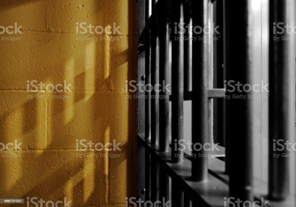 Shadows from a jail cell stock photo