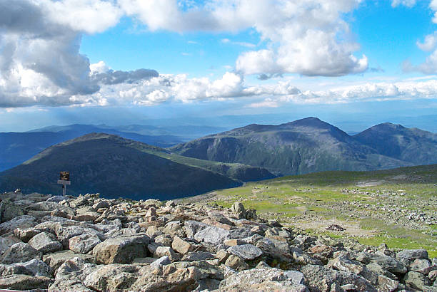 Shadows From Clouds on the Mountains Shadows on a mountain range from incoming clouds at Mount Washington mount washington new hampshire stock pictures, royalty-free photos & images