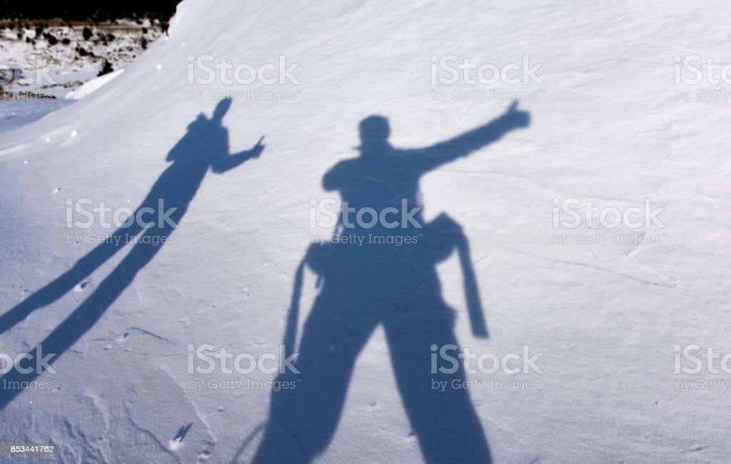 shadows of adventurous climbers stock photo