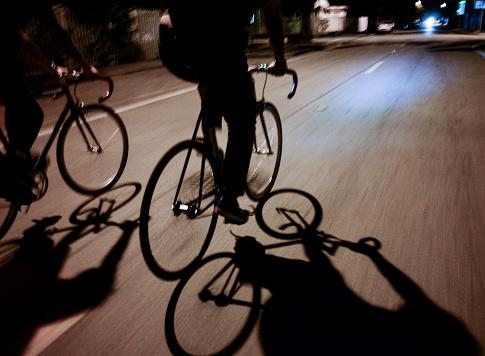 Shadows of Bicycle Riders at Night