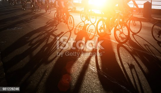istock Shadows of bike riders at dawn 931226246