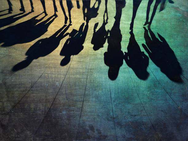 Shadows of group of people walking on the street