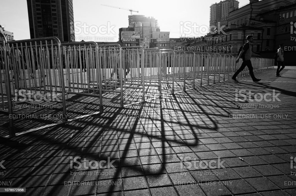 Shadows Of Metallic Barrier Gates On Sunny Day Stock Photo