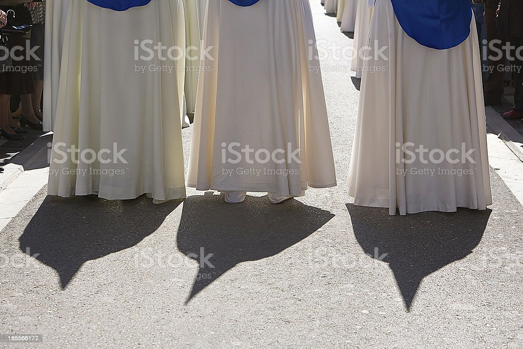Shadows of penitents on Holy week procession, Spain royalty-free stock photo
