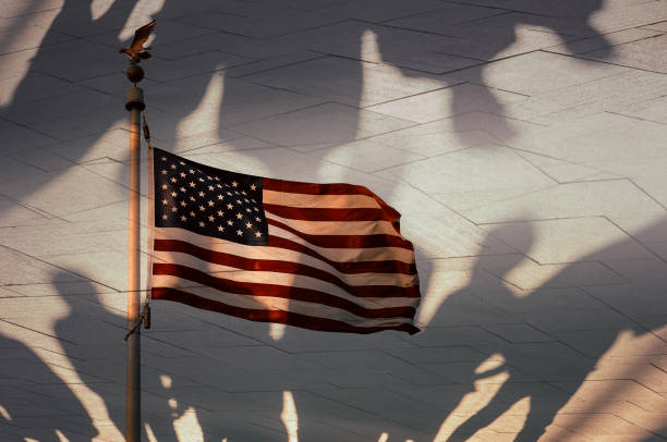 Shadows of people and the American flag, conceptual photography Shadows of people and the American flag, conceptual photography department of homeland security stock pictures, royalty-free photos & images