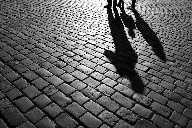 Shadows of people Shadows of people walking in a street of the city, Prague, September 2010. arcane stock pictures, royalty-free photos & images