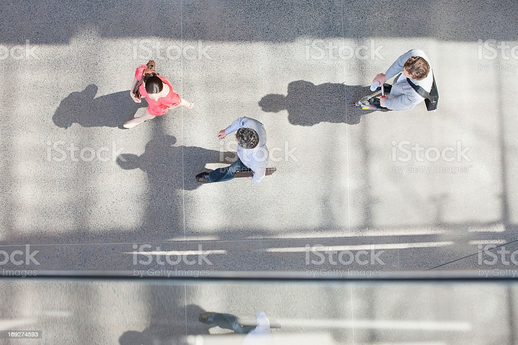 Shadows of people walking from directly above