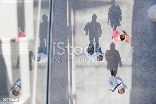 istock Shadows of people walking from directly above 97970805