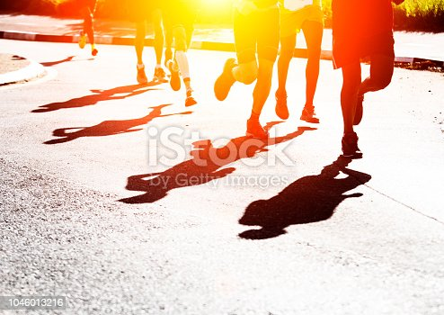 Shadows of runners on the road