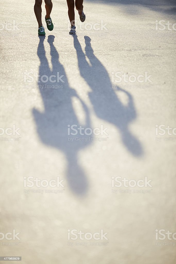 Shadows of runners stock photo