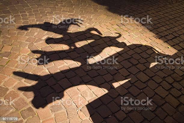 Shadows of town musicians against a cobblestoned path picture id92119729?b=1&k=6&m=92119729&s=612x612&h=ddb xrpx29mnxhwbidjpwsdqaty f539dpkfft1lije=