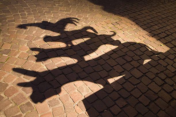 Shadows of town musicians against a cobblestoned path picture id92119729?b=1&k=6&m=92119729&s=612x612&w=0&h=tmy3znh20ucwrqxca7dpph1pdye7eoxogj5x4vayvhu=