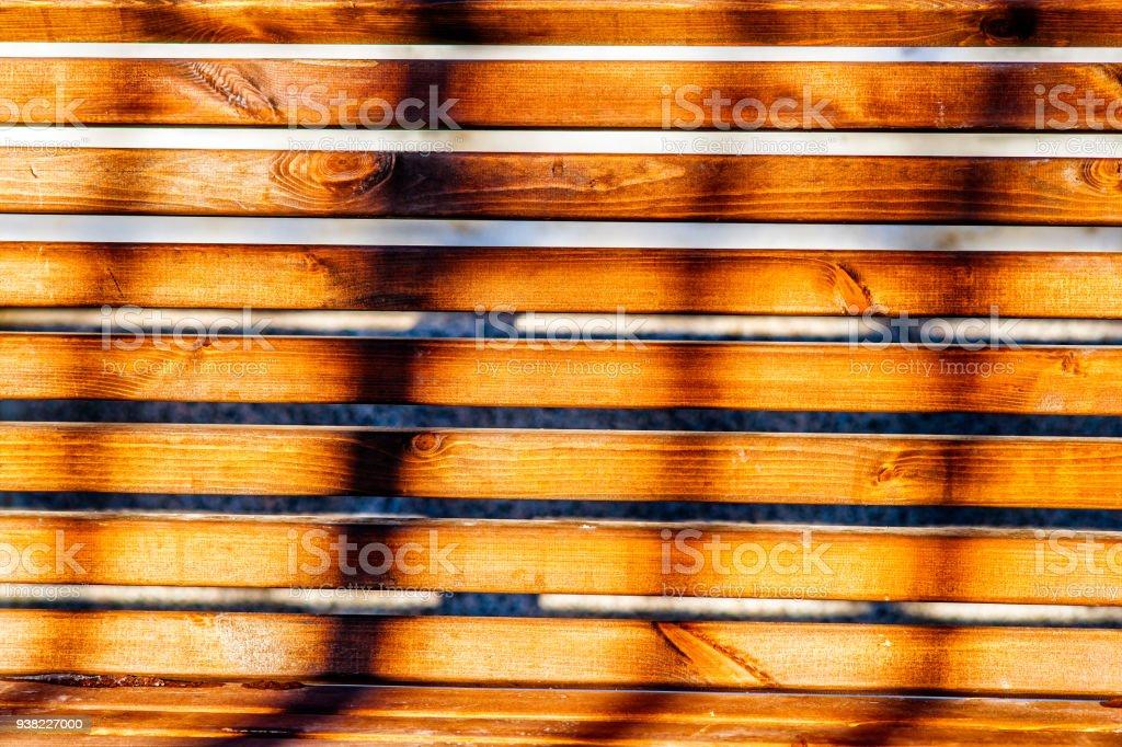 Shadows on a garden bench stock photo