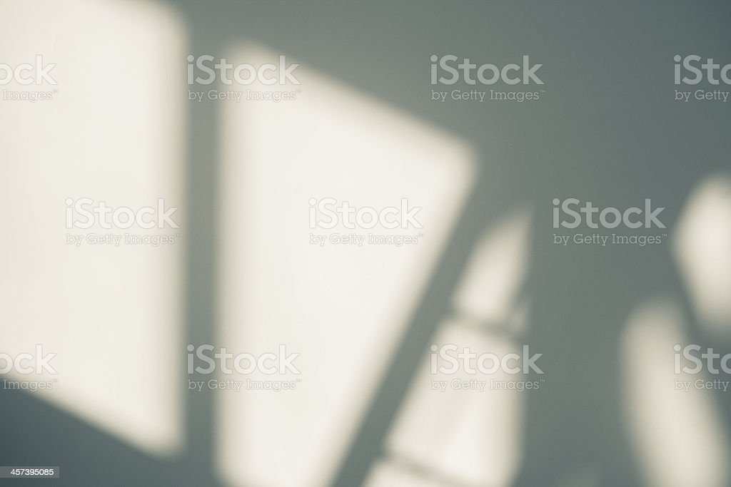 Shadows on a wall background. stock photo