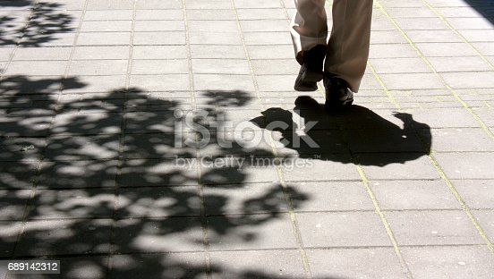 istock Shadows on spring sidewalk 689142312