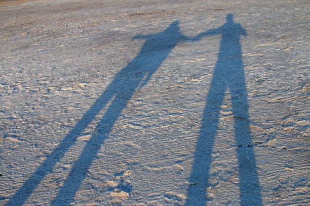 Shadows on the salt crust of the surface of the estuary.