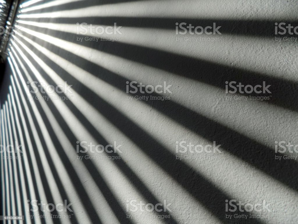 Shadows On The Wall From The Windows Blinds Stock Photo More