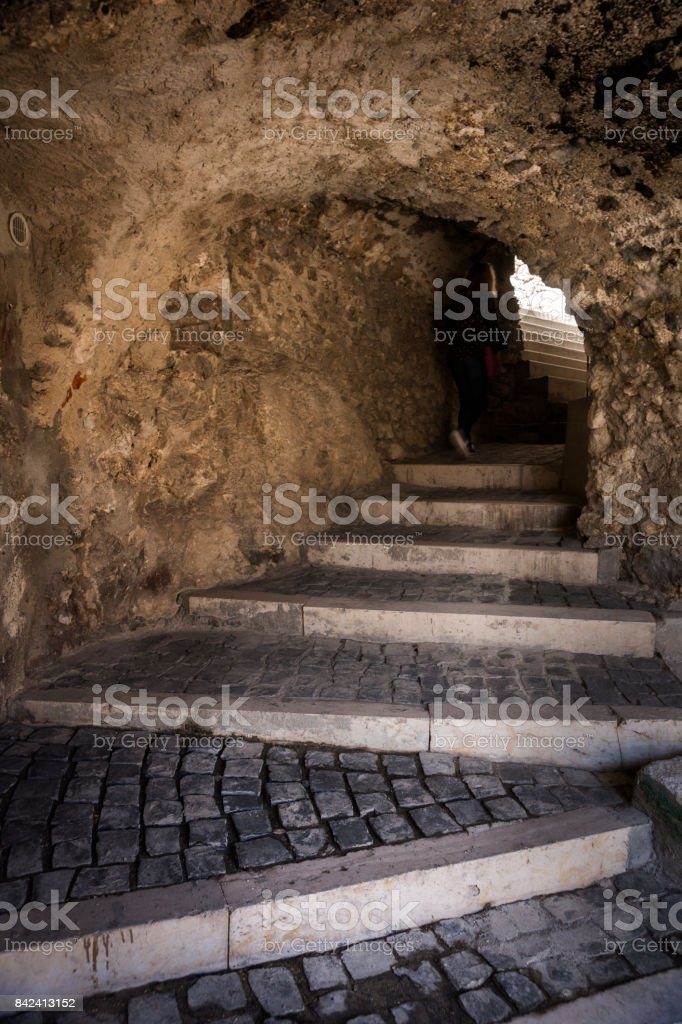 Shadowy figure walks through tunnel stock photo