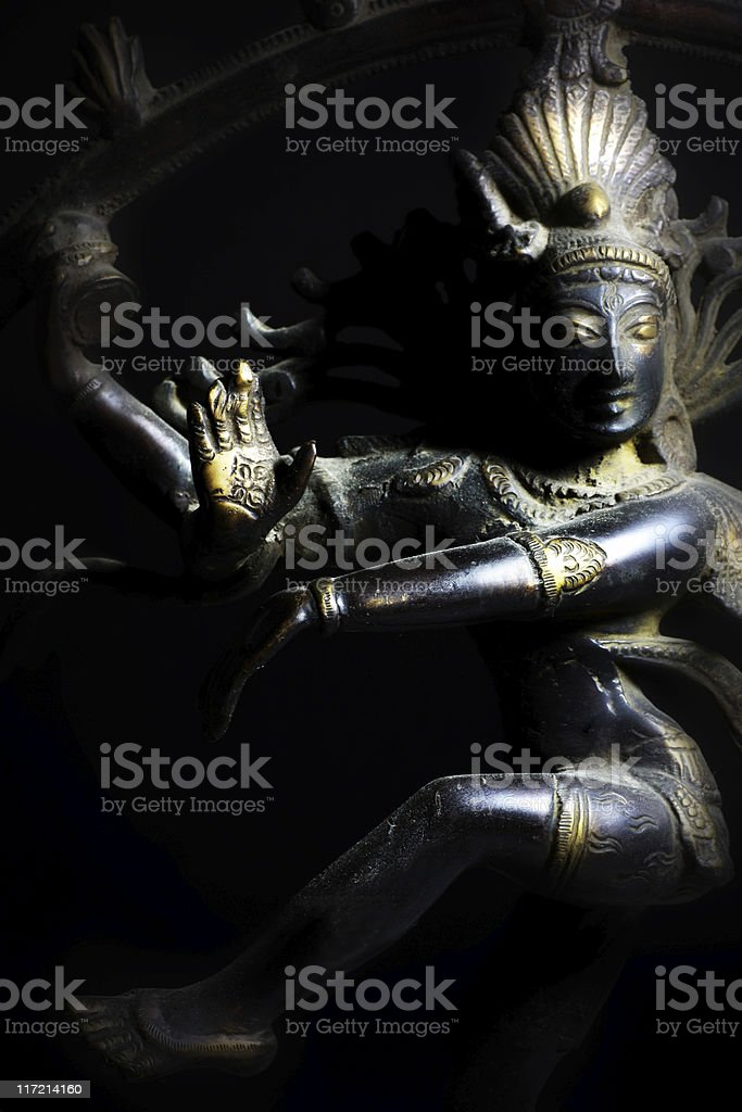 Shadowy Shiva statue with natural light stock photo