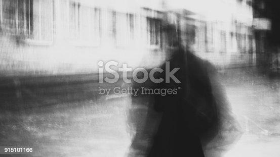 istock shady person walking 915101166