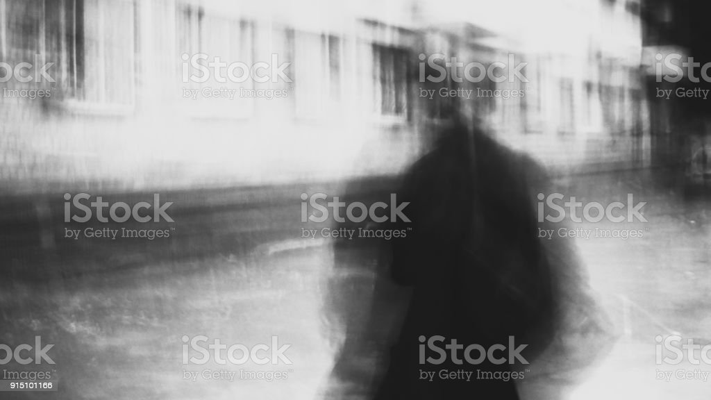 shady person walking stock photo