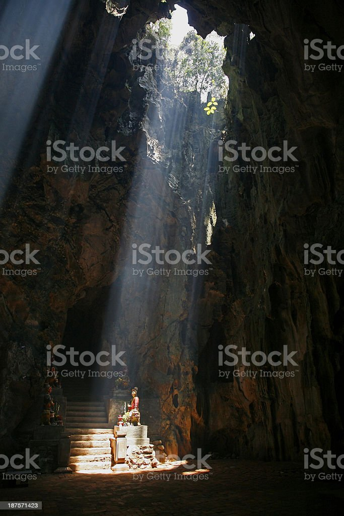 Shaft of light on temple guards, Marble Mountain stock photo