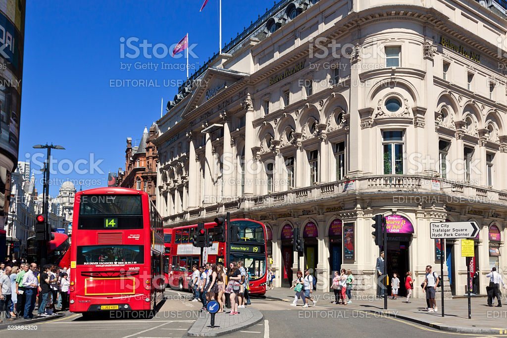 Shaftesbury Avenue with Red Double Decker Bus and Tourists, London. stock photo