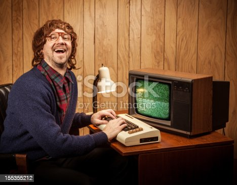 618210072 istock photo Shaggy haired Geeky Nerd Computer work man vintage style 155355212