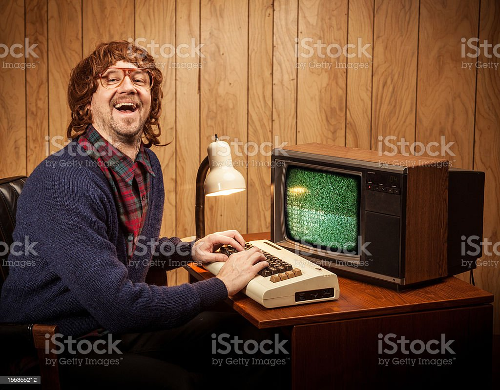 Shaggy haired Geeky Nerd Computer work man vintage style stock photo