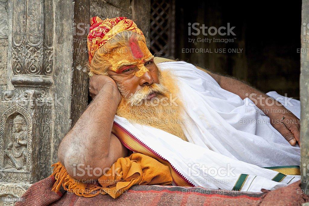 Shaiva sadhu seeks alms on the Pashupatinath Temple  in Kathmand royalty-free stock photo