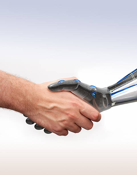 shake hands with new technologies stock photo