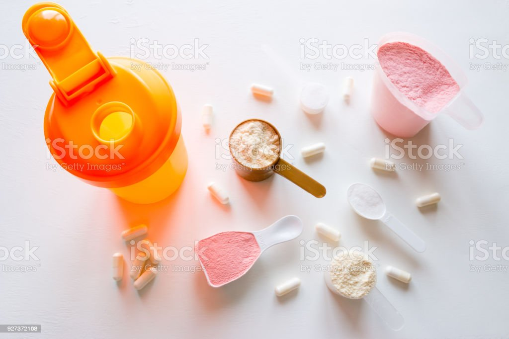 shaker and sport supplements - protein, gainer, creatine, bcaa shaker and sport supplements - protein, gainer, creatine, bcaa Acid Stock Photo
