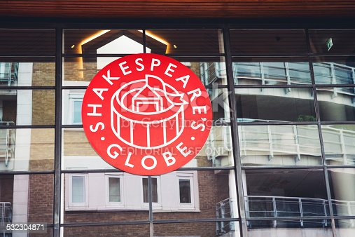 London, UK - October 26, 2013: Shakespeare's Globe Theatre sign located on a glass facade of new Globe on New Globe Walk in London, UK.