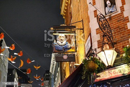 istock Shakespeare's head pub in the Carnaby street decorated for Christmas. 1160851045