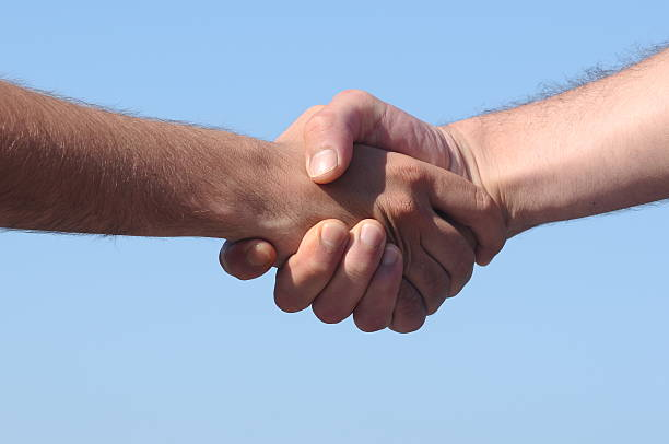 shaking hand - hand grip stock photos and pictures