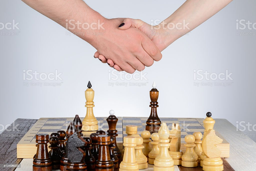 Shaking hands after a game of chess stock photo