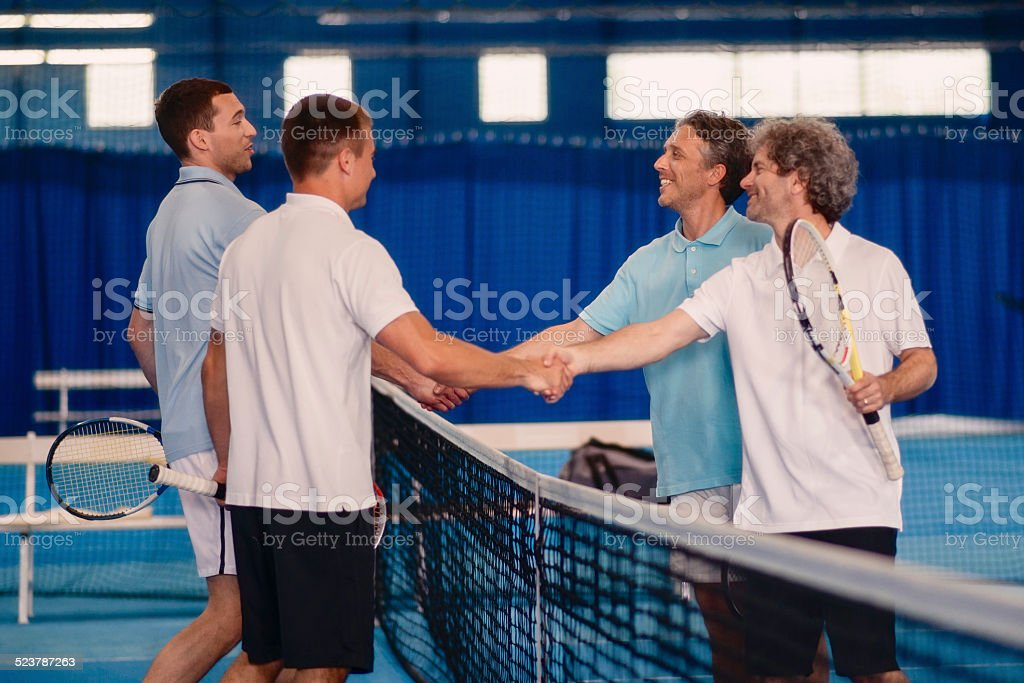 Shaking Hands After Tennis Match stock photo