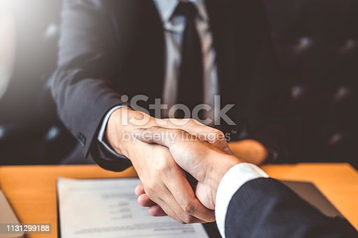 istock Shaking hands Business people greeting new colleagues while job interviewing shaking hands meeting Planning after during job interview Concept 1131299188