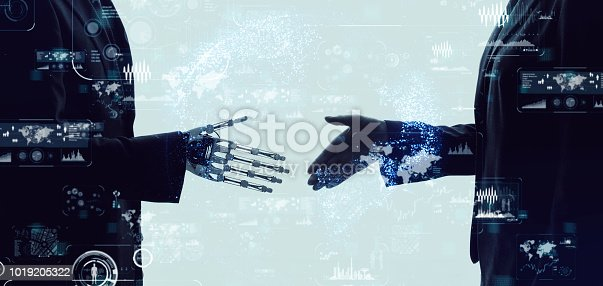 istock Shaking hands of a businessperson and a robot. 1019205322