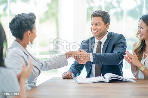 600073884 istock photo Shaking Hands to Close a Deal 693469180