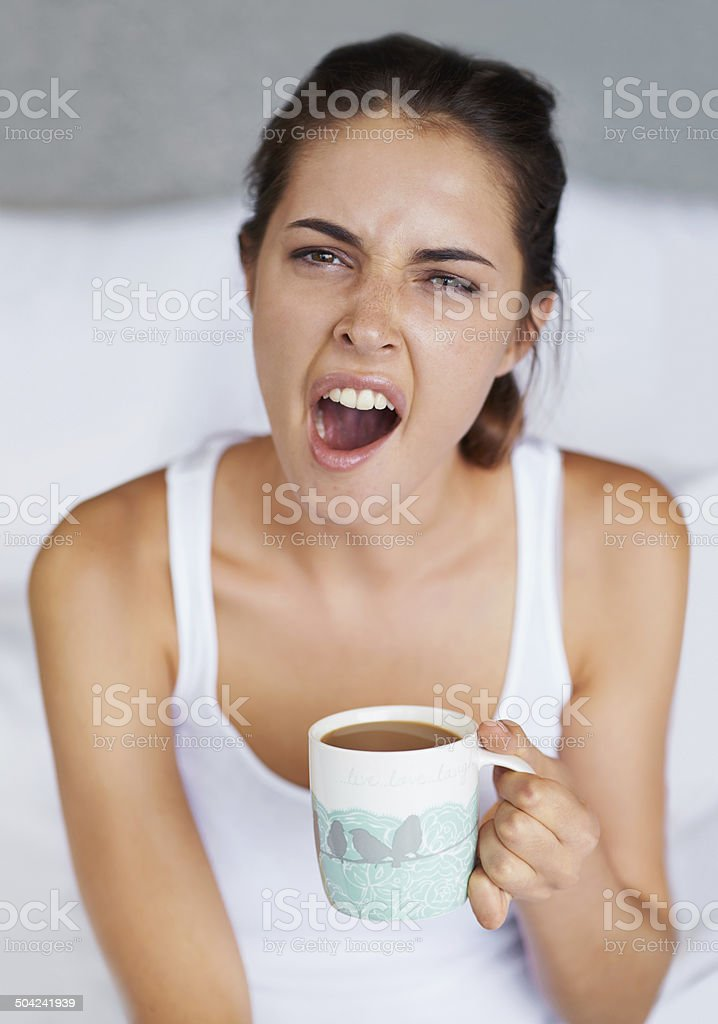 Shaking off the sleep with some coffee stock photo