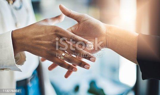 Closeup shot of two businesswomen shaking hands in an office