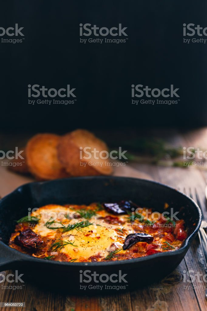 Shakshuka dish in a irom cast pan - Royalty-free Backgrounds Stock Photo