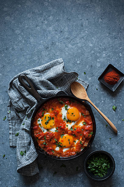 shakshuka - algeria stock photos and pictures