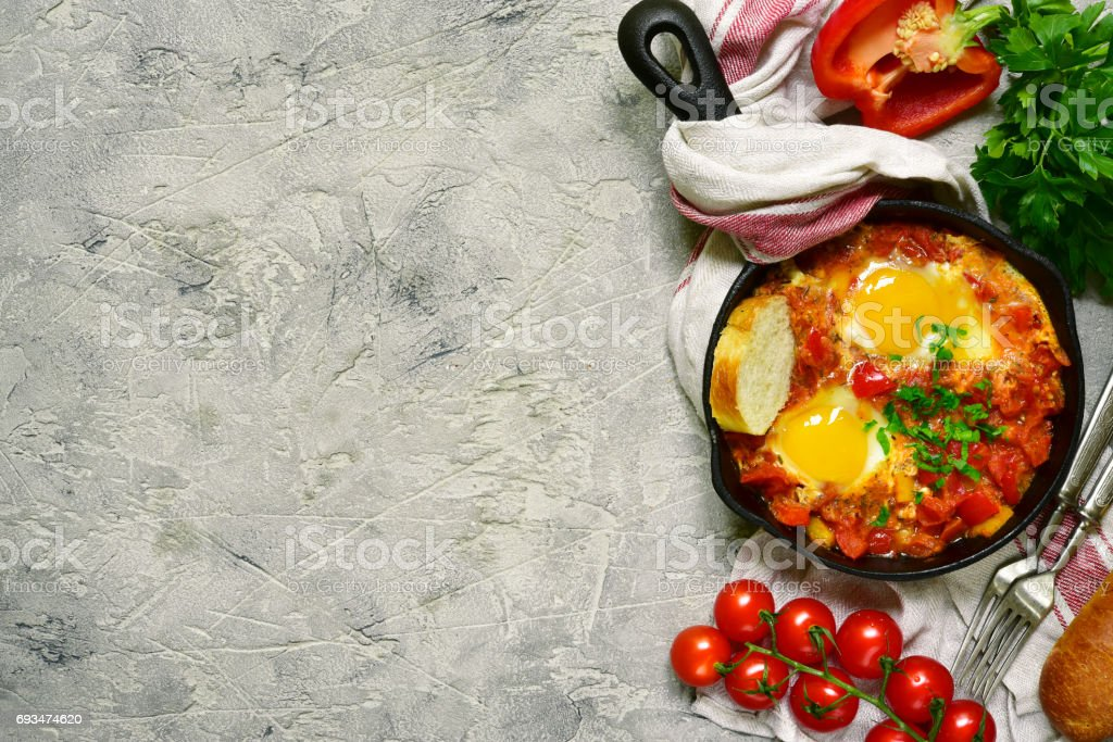 Shakshuka-traditional israeli tomato stew with eggs stock photo