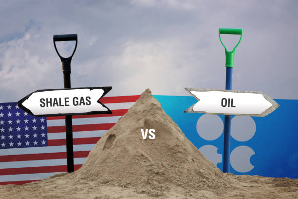 shale gas(usa flag) vs oil(opec flag) - kuwait currency stock photos and pictures